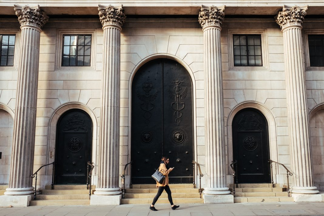 Woman walking in front of a building